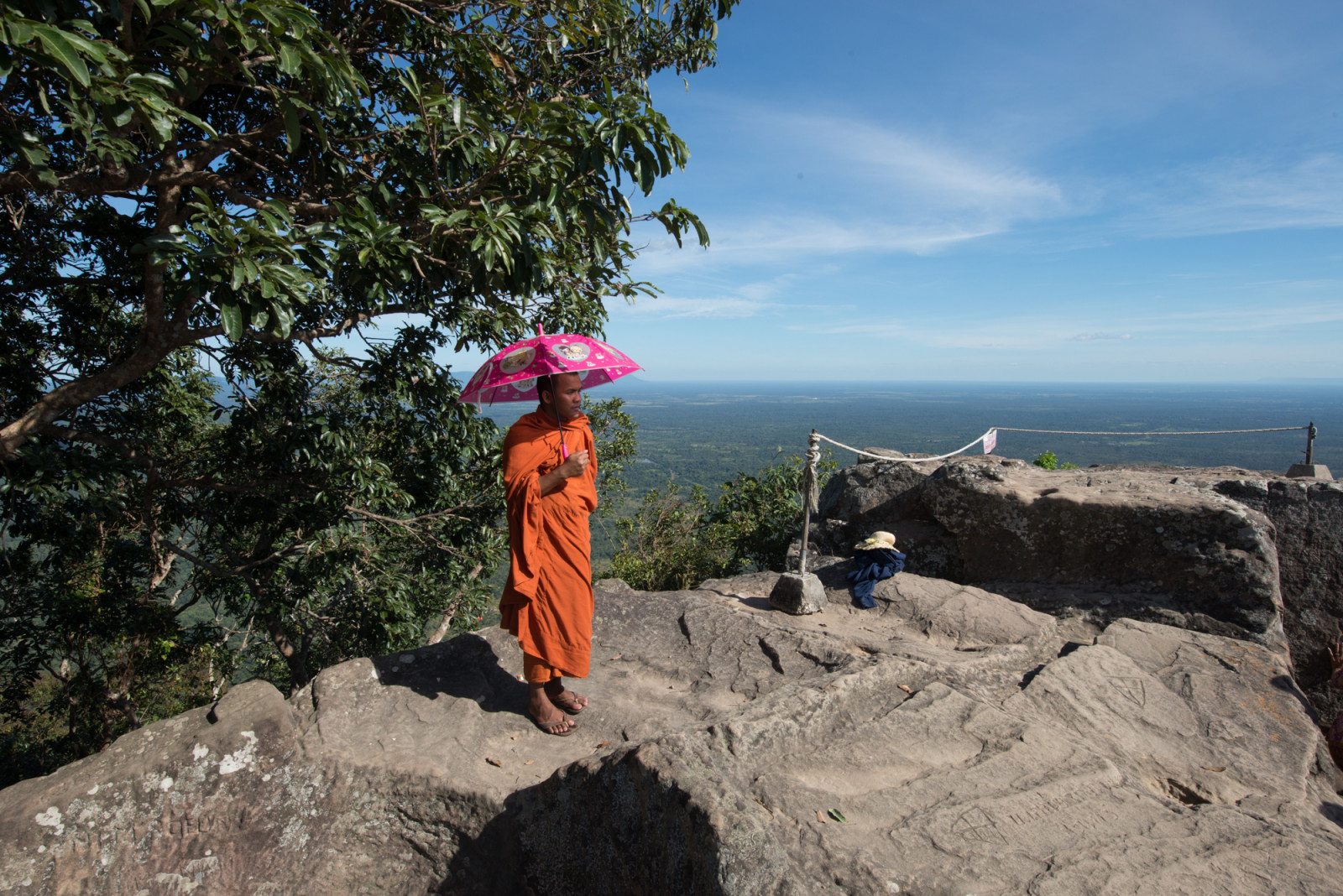 Cambodia photo tours Preah Vihear temple monk holding umbrella