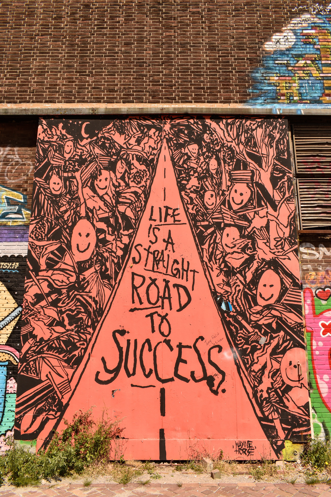 Life is a straight road to success street art Amsterdam