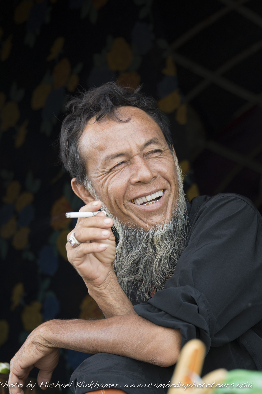 Cham man smoking cigarette