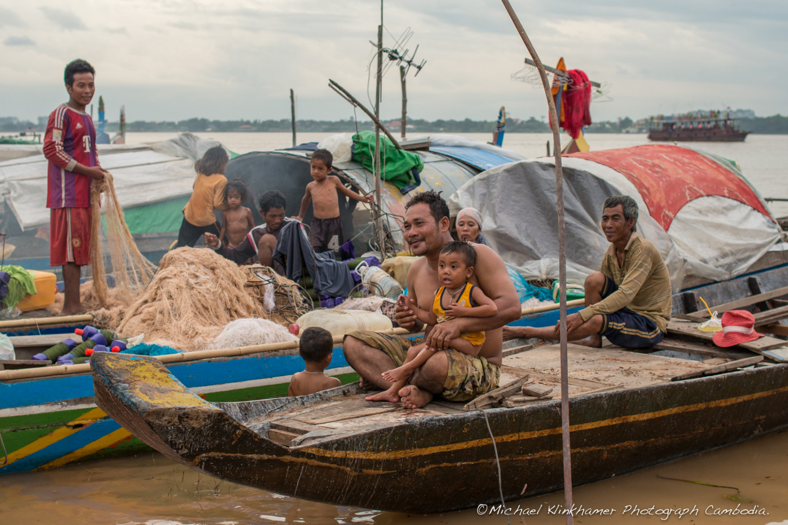 Cham family working on  boat Phnom Penh
