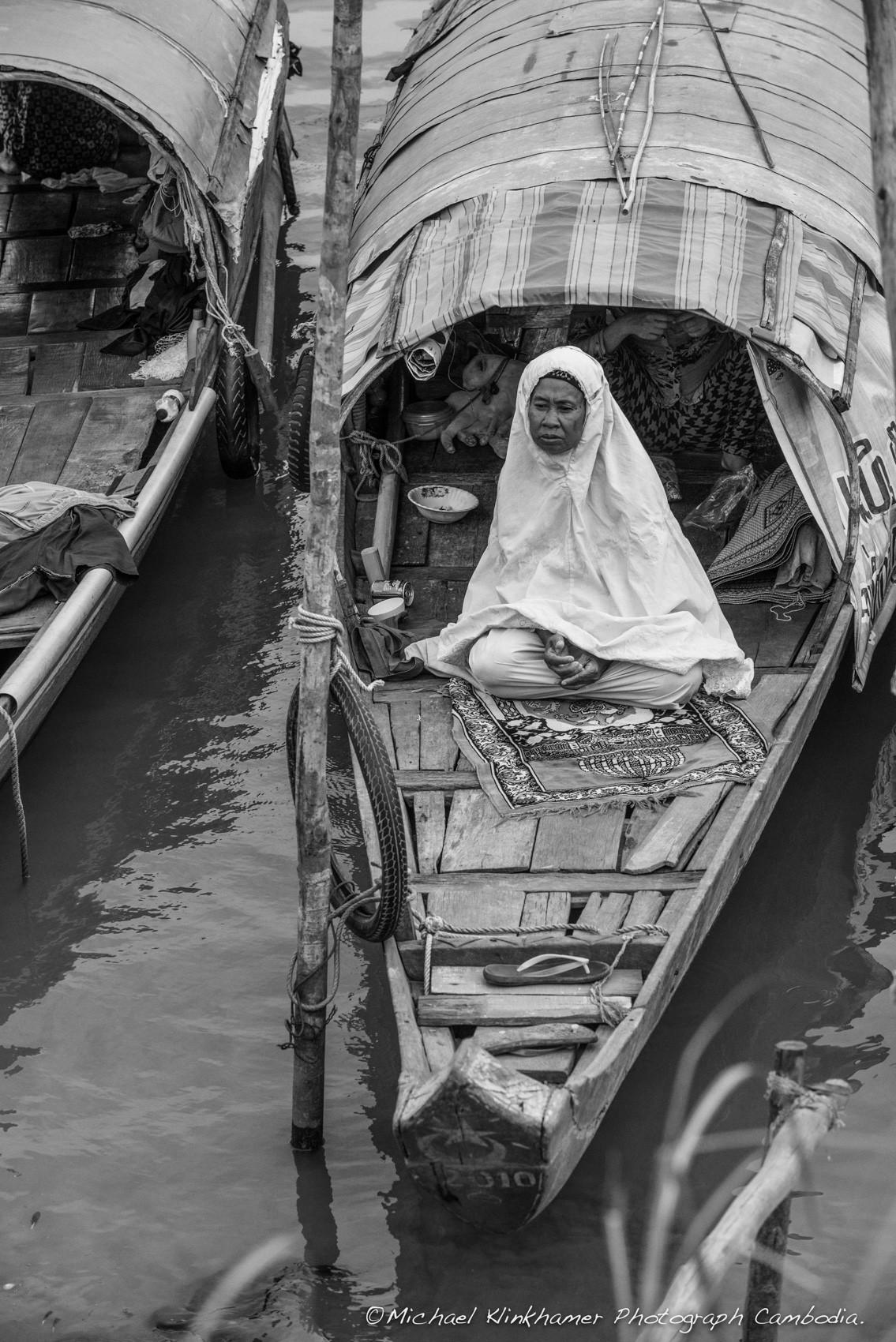 Cham woman praying on boat